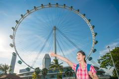 Happy Asia woman Travel in Singapore, Singapore Flyer - stock photo