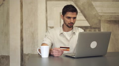 Mixed race businessman online banking Stock Footage