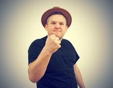 Gangster in  hat angry man holding fists against. Stock Photos