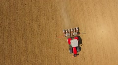 Aerial view of Tractor sowing seeds of corn. Stock Footage
