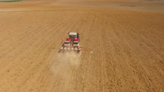 Tractor sowing seeds of corn. Stock Footage