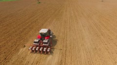Tractor sowing seeds of corn. - stock footage