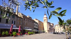 A storic corner of italian town behind olive Stock Footage