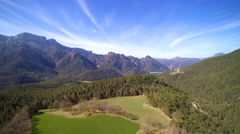 Aerial view: Rural landscape. Rugged mountains Stock Footage