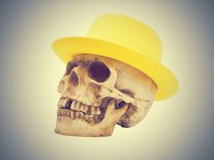Skull in the yellow hat - stock photo