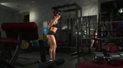 beautiful sporty sexy girl doing squat workout in gym - stock footage