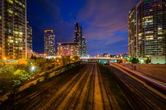 Railroad tracks and modern buildings at night, in downtown Toronto, Ontario. Stock Photos