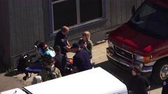 TRANSFERRING VICTIM TO AMBULANCE, MOCK DISASTER , - stock footage