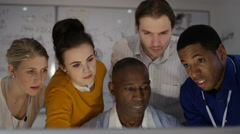 4K Engineering team working together, looking at computer screen Stock Footage