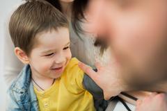 Little boy medical visit - doctor measuring blood pressure of a child Kuvituskuvat