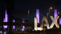 LAX AIRPORT ENTRANCE NIGHT WIDE PURPLE Stock Footage