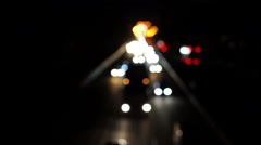Night view of interstate road, defocused cars moving slowly in traffic jam - stock footage