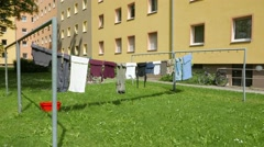 4K SteadyCam Laundry Clothes drying in the sun courtyard greenery grassland Stock Footage