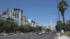 Buenos Aires, obelisk and traffic on 9 July avenue , Argentina - stock footage