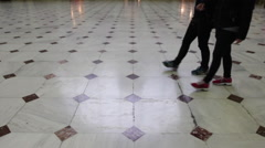 People walking on a patterned floor at Union Station in Washington DC. No faces. Stock Footage