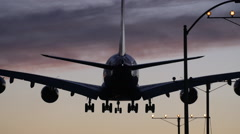 DRAMATIC 747 LANDING AT SUNSET - stock footage
