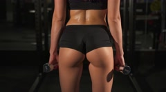 Fitness erotic girl with dumbbells from behind - stock footage