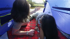 4K Attractive hipster couple sharing intimacy in their tent on camping trip Stock Footage