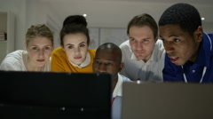 4K Happy engineering team working together, looking at computer screen Stock Footage