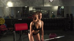 Beautiful athletic woman doing workout in gym Stock Footage