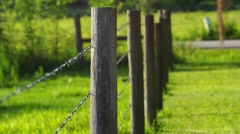 Barbed wire Farm Fence With Short Depth of Field Stock Footage