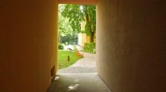 4K SteadyCam Walking through tunnel to beautiful courtyard apartment garden park Stock Footage