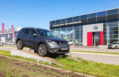 Nissan X-Trail parked up near the office of official dealer Nissan Stock Photos