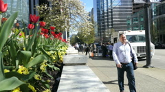People Coming And Going On Beautiful Spring Day In Downtown Vancouver Stock Footage
