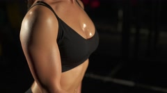Fitness erotic girl pumping muscles - stock footage