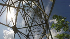Electrical pylon construction against blue cloudy sky, time lapse 4K Stock Footage