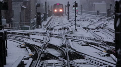 NYC subway train pulls into station on a snowy day Stock Footage