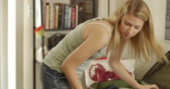 Woman packing Stock Footage