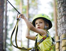 little cute boy in helmet runs track, leisure on nature extreme - stock photo