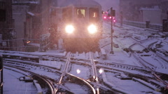 NYC subway entering the station on a snowy evening Stock Footage