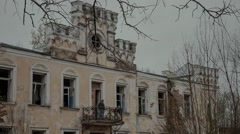 Tourists walking on old abandoned Russian country estate in the style of classic Stock Footage