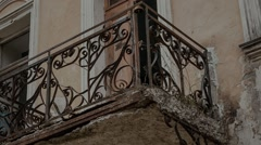 Wrought iron balcony in an old abandoned dilapidated Russian estate Stock Footage