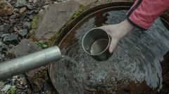 The traveler pours spring water into a glass to quench your thirst Stock Footage