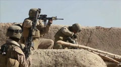 War in Afghanistan - United States Marine shooting at enemy Stock Footage