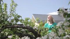 Female graduate on a tree cheering Stock Footage