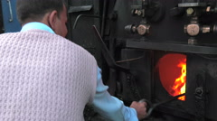 Darjeeling Himalayan Railway, India. Stoking the furnace. Stock Footage