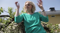 Woman up on tree with graduation hat Stock Footage