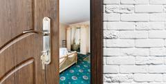 Half open door of a classic bedroom closeup Stock Photos