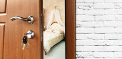 Half open door of a classic bedroom closeup - stock photo