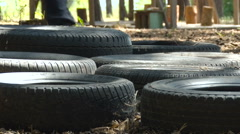 Military Training. Running on Tires. Closeup. Legs in Military Uniform, Boots Stock Footage
