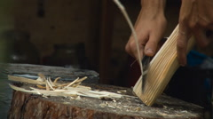 Whittling a Piece of Wood With a Knife. Stump, Hands, Shaving, Work. Closeup Stock Footage