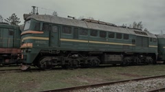 Old abandoned passenger train cars and locomotives Stock Footage