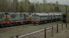 old abandoned passenger train cars and locomotives - stock footage
