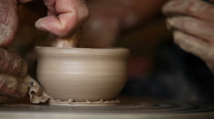 Potter works with clay bowl in workshop Stock Footage