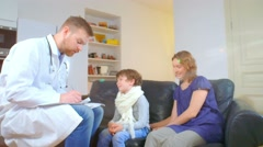 home doctor came to sick boy and his mother. he examines a child and records - stock footage