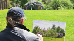 Artist work 'en plein air' lilac. Stock Footage